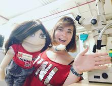 Justine LaViolette with a puppet in the lab